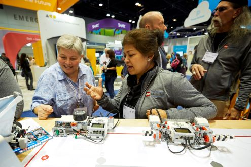 Two women explore the expo hall at the ISTE Conference & Expo