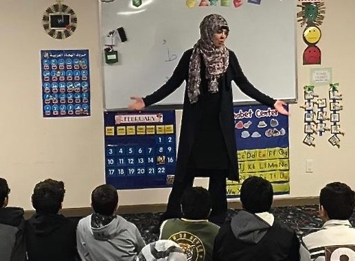 Nadia Abuisnaineh, a Solar System Ambassador for NASA, teaches students about space.