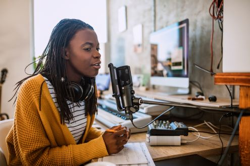 A teacher recording a podcast